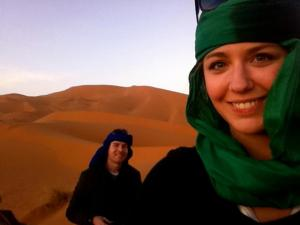 Sitting on camels in the Sahara desert
