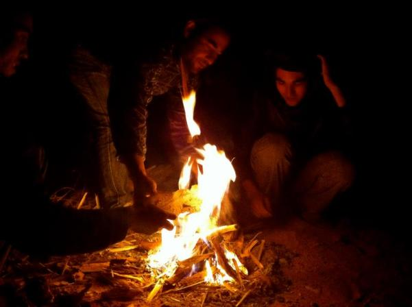 By the campfire at night
