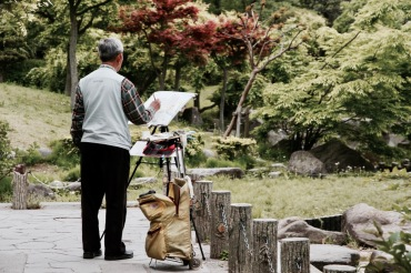 Local man painting in a garden