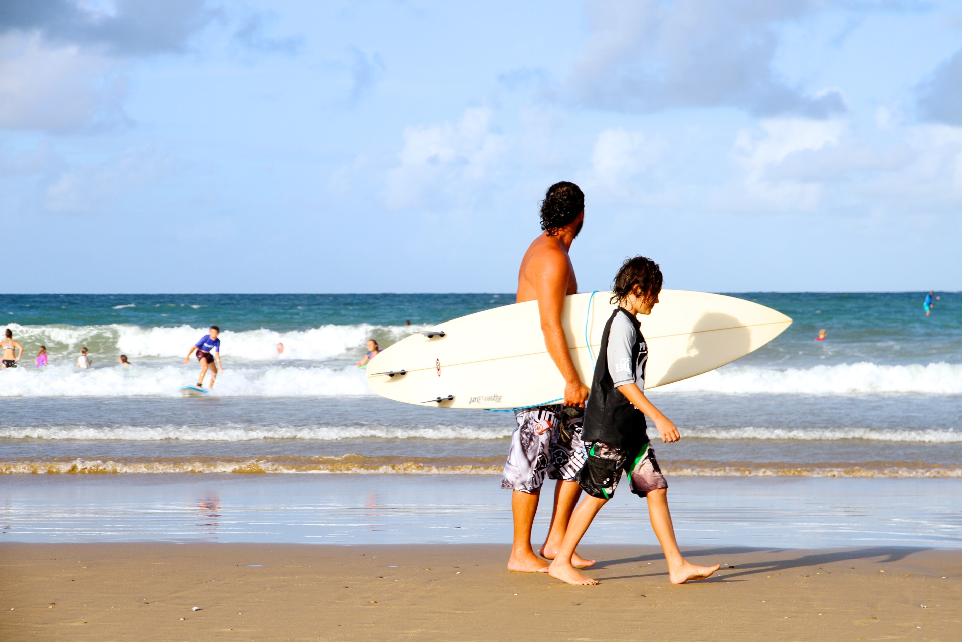 Father and son surf at Agnes Water
