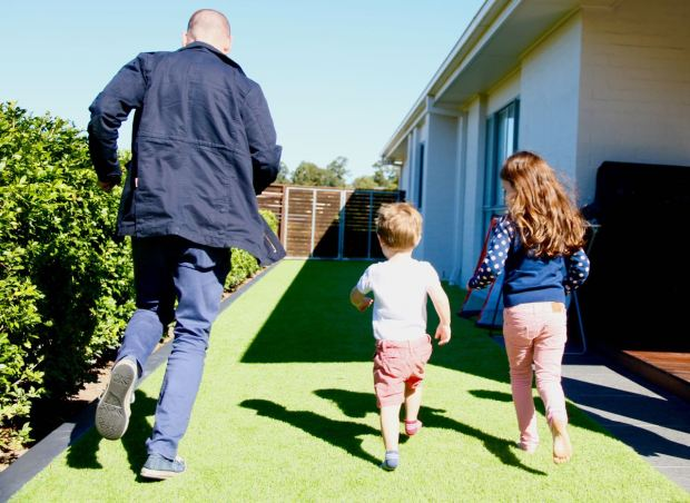This is a photo of Matt having a foot race with our niece and nephew. They're the cutest little kids.