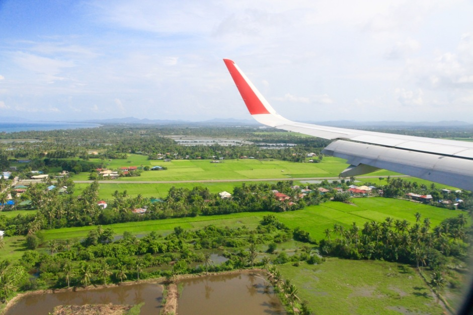 Flying from Kuala Lumpur to Kalibo Boracay Philippines landing at airport airasia